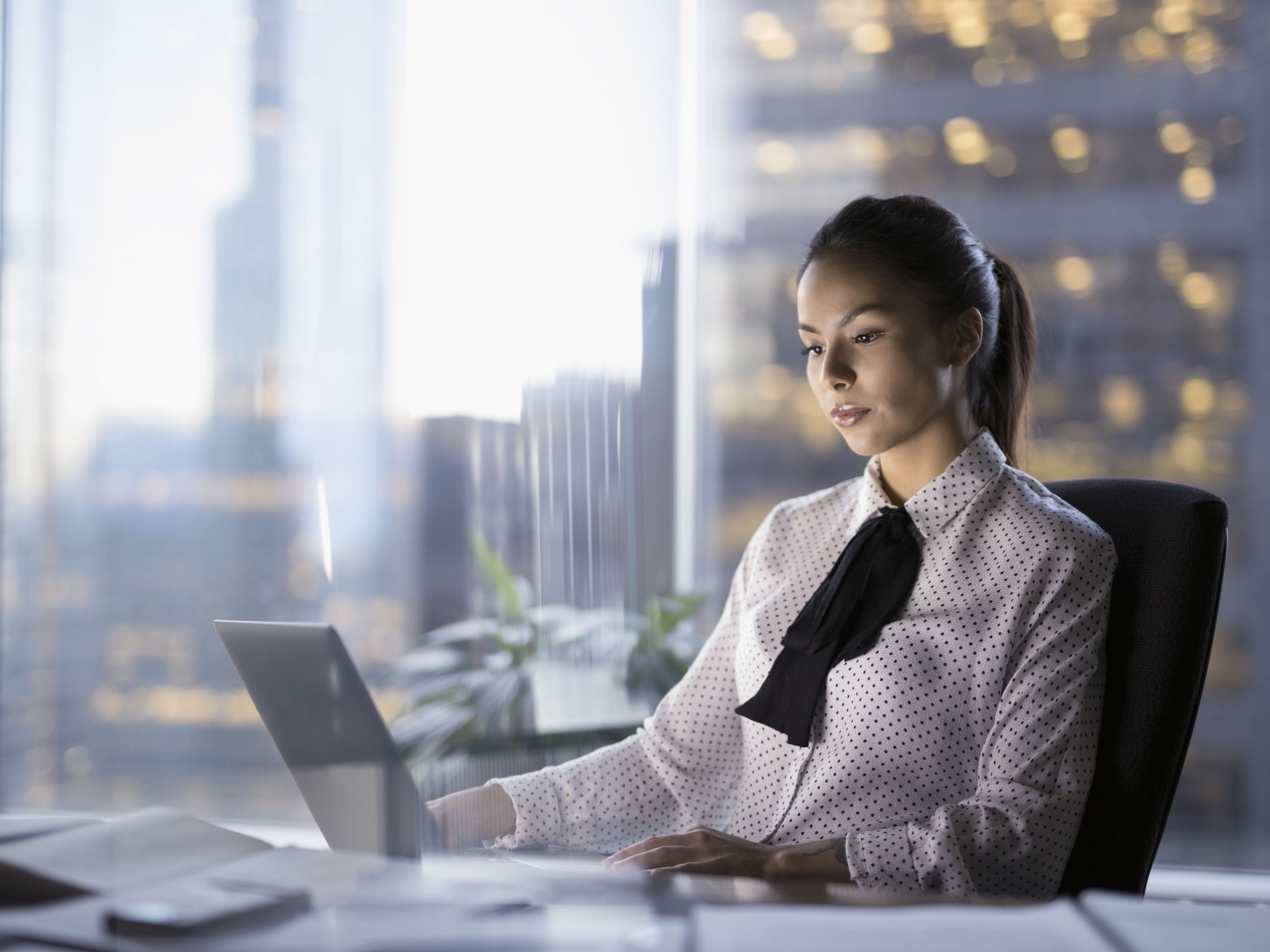 female-lawyer-working-late-at-laptop-in-urban-office-697540591-59a4712968e1a20013536419